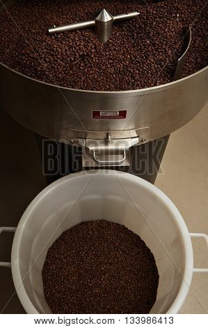 Freshly Baked Aromatic And Dark Coffee Beans In The Best Professional Roasting Machine, Ready For Pa