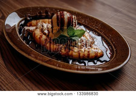 Fresh banana split with ice-cream on the dish in cafe