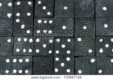 Background with a group of old and vintage wooden pieces of the domino game