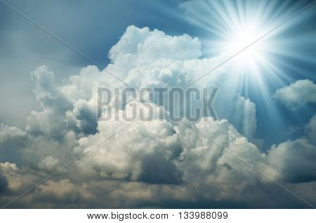 Bright Sun Shines Among The Dark Clouds. Lens Flare.