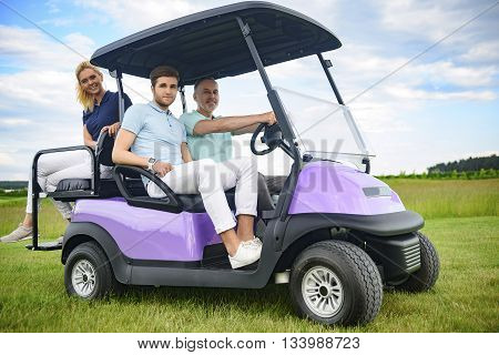 Enjoying nice round of golf in style. Happy family spending their weekend, driving golf cart