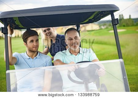 This how we like to spend our weekends. Close up of happy family, driving on golf cart, spending time together