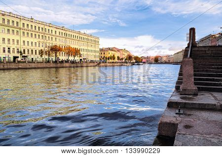ST PETERSBURG RUSSIA - OCTOBER 20 2012. Architecture landscape of old historic buildings along the embankment of Fontanka river in St Petersburg autumn architecture view