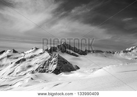 Black And White View On Off-piste Slope At Sun Evening