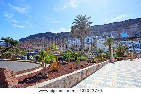 TAURITO, GRAN CANARIA, SPAIN - APRIL 20, 2016: Promenade to the beach in Taurito, Gran Canaria. Taurito is very popular tourist destination