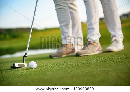 Quiet on the field please. Close up of golfers halding driver and getting ready for swing