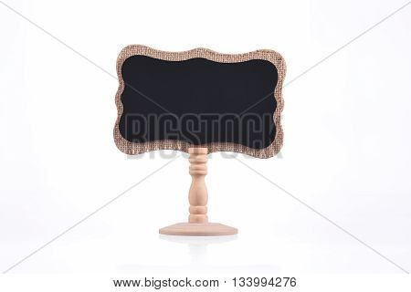 Blackboard on wooden stand isolated on white background