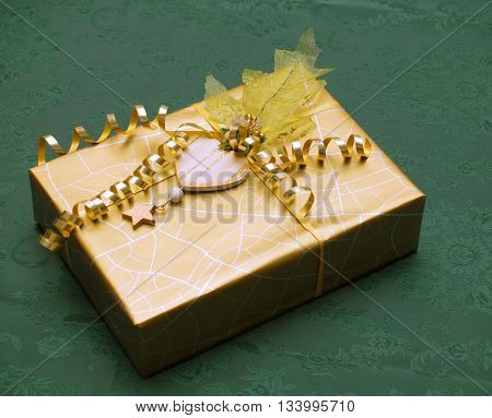 Very luxury packed  gift with heart decoration and gold ribbon