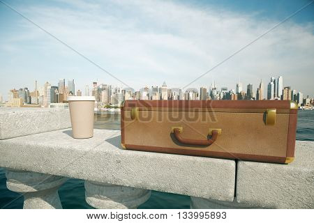 Clouseup of closed suitcase and coffee cup on concrete bridge railing with bright city in the background. 3D Rendering