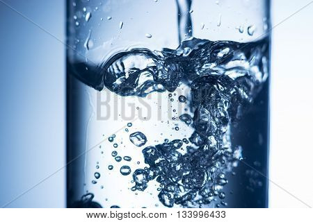 Close up of crystal water splash in a glass
