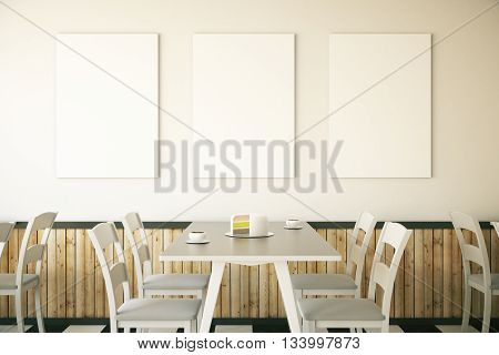Cafe interior with cake on table and three blank posters on light wall. Mock up 3D Rendering