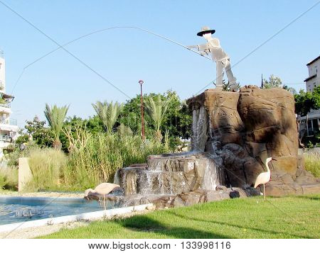 Fisherman fountain on the square in Or Yehuda Israel
