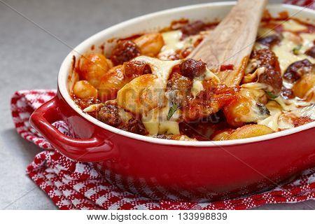 Potato gnocchi with italian sausage and tomato sauce