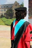 stock photo of graduation gown  - asian university student in gowns on graduation day - JPG