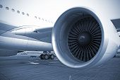 stock photo of rotor plane  - engine of passenger airplane waiting in airport - JPG