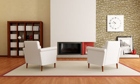 picture of ami  - two white armchair in front a minimalist fireplace and stone wall - JPG