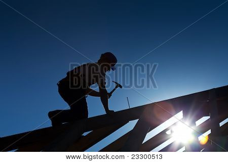 Builder Or Carpenter Working On The Roof