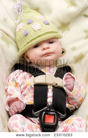 Baby In Knit Hat With Expression