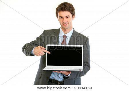 Modern Businessman Pointing On Laptops Blank Screen