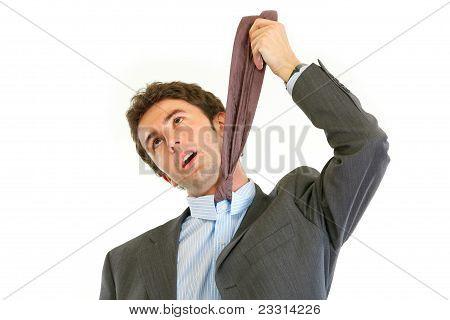 Stressed Businessman Hanging Himself On His Necktie