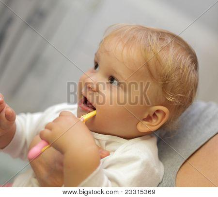 Baby Girl Brushing Her Teeth