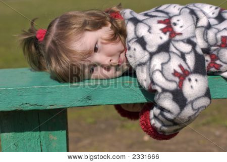 Girl Lying On Bench