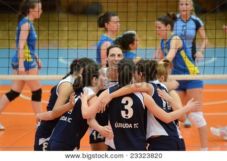 KAPOSVAR, HUNGARY - APRIL 24: Ujbuda players celebrate at the Hungarian NB I. League woman volleyball game Kaposvar (blue) vs Ujbuda (black), April 24, 2011 in Kaposvar, Hungary.