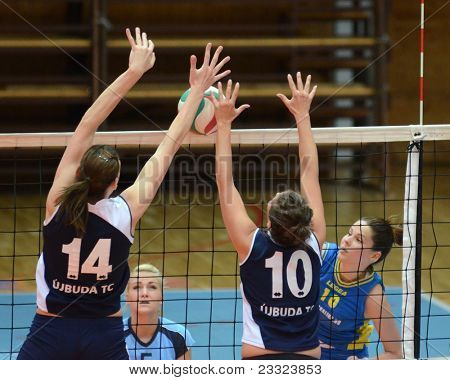 KAPOSVAR, HUNGARY - APRIL 24: Szandra Szombathelyi (R) in action at the Hungarian NB I. League woman volleyball game Kaposvar (blue) vs Ujbuda (black), April 24, 2011 in Kaposvar, Hungary.