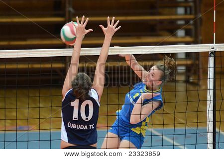 KAPOSVAR, HUNGARY - APRIL 24: Zsanett Pinter (R) in action at the Hungarian NB I. League woman volleyball game Kaposvar (blue) vs Ujbuda (black), April 24, 2011 in Kaposvar, Hungary.