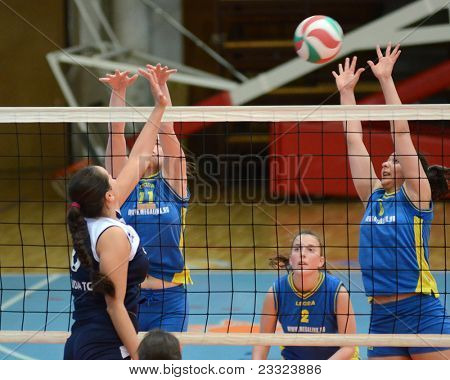 KAPOSVAR, HUNGARY - APRIL 24: Barbara Balajcza (R) in action at the Hungarian NB I. League woman volleyball game Kaposvar (blue) vs Ujbuda (black), April 24, 2011 in Kaposvar, Hungary.
