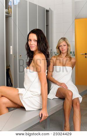 Locker Room Two Relaxed Women Wrapped In Towel