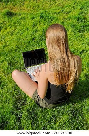 Girl With Laptop Sitting On Lawn