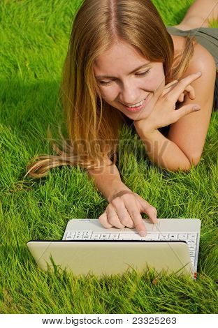 Girl On Lawn Working On Laptop