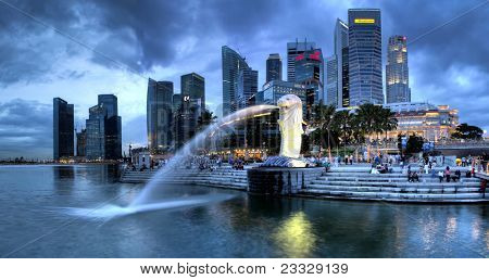 SINGAPORE-DEC 29: The Merlion fountain and Singapore skyline on Dec. 29, 2010. Merlion is an imaginary creature with head of a lion and the body of a fish and is often seen as a symbol of Singapore.
