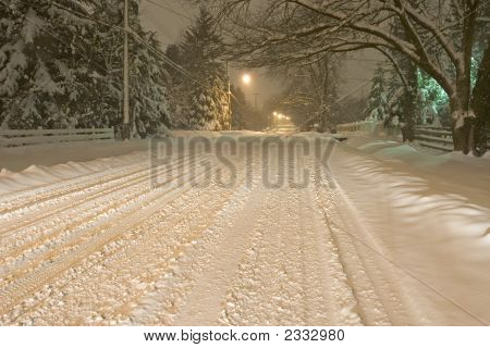 Snowy Road At Night