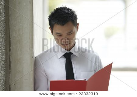 Asian Business Man Reading Documents
