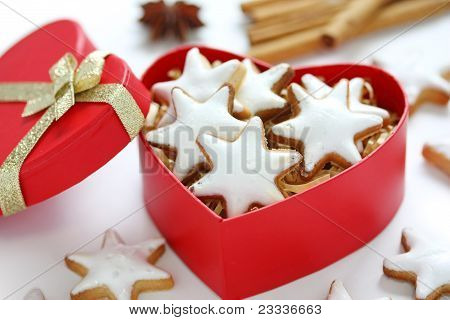 Zimtstern , homemade christmas cookies in a red heart shaped box