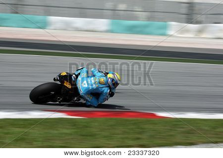 SEPANG, MALAYSIA - FEBRUARY 2: MotoGP rider  Alvaro Bautista of Rizla Suzuki MotoGP team practices at the 2011 MotoGP winter tests at the Sepang International Circuit. February 2, 2011 in Malaysia.