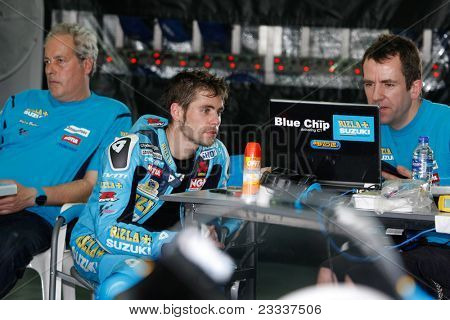 SEPANG, MALAYSIA - FEBRUARY 22: Alvaro Bautista of the Rizla Suzuki Team talks with engineers at the 2011 MotoGP winter tests at the Sepang International Circuit on February 22, 2011 in Sepang, Malaysia