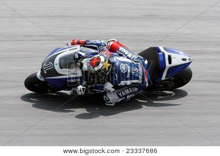 SEPANG, MALAYSIA - FEBRUARY 23: MotoGP rider Jorge Lorenzo of Yamaha Factory Racing Team practices at the 2011 MotoGP winter tests at the Sepang International Circuit. February 23, 2011 in Malaysia.