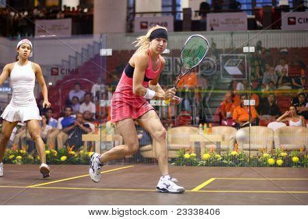 KUALA LUMPUR, MALAYSIA - MARCH 18: World #1 Nicol David (white) plays Kasey Brown (Australia) at the quarterfinals of the CIMB KL Open Championship 2011 on March 18, 2011 in Kuala Lumpur, Malaysia.