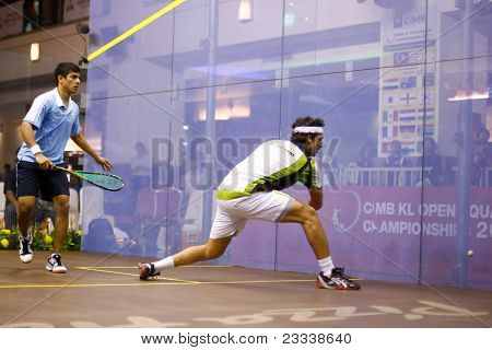 KUALA LUMPUR, MALAYSIA - MARCH 18: Top seed Karim Darwish, Egypt plays Saurav Ghosal, India (blue) at the quarterfinals of the CIMB KL Open Championship 2011 on March 18, 2011 Kuala Lumpur, Malaysia.