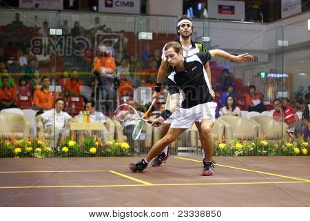 KUALA LUMPUR, MALAYSIA - MARCH 19: Top seed Karim Darwish, Egypt (white) plays Gregoire Marche, France at the semifinals of the CIMB KL Open Championship 2011 on March 19, 2011 Kuala Lumpur, Malaysia.