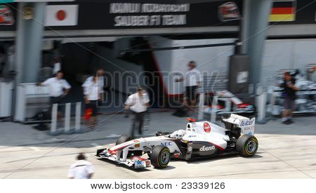 SEPANG, MALAYSIA - APRIL 8: Kamui Kobayashi of Sauber F1 Team returns to the pit for checks on the first practice day of the Petronas Malaysian F1 Grand Prix on April 8, 2011 Sepang, Malaysia.