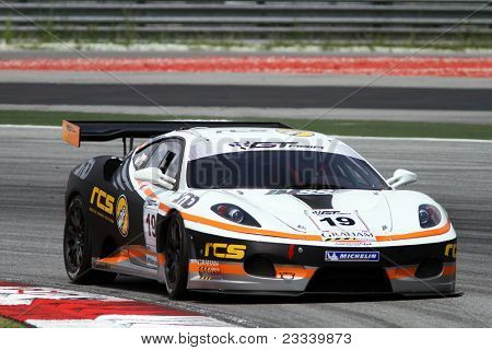 SEPANG - JUNE 17: Eric Lo (19) in a Ferrari takes to the tracks of the Sepang International Circuit at the GT Asia Series race on June 17, 2011 in Sepang, Malaysia.