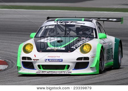 SEPANG - JUNE 17: Sasha Chu (11) from the Asia Racing Team in a Porsche takes to the tracks of the Sepang International Circuit at the GT Asia Series race on June 17, 2011 in Sepang, Malaysia.