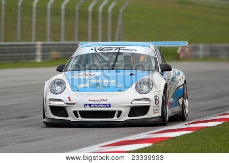 SEPANG - JUNE 17: Christian Chia in a Porsche 997 Cup 3.8 takes to the tracks of the Sepang International Circuit at the GT Asia Series race on June 17, 2011 in Sepang, Malaysia.