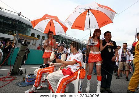 SEPANG - JUNE 19: The Lexus Team LeMans Eneos' drivers wait before the start of the race in the Sepang Circuit during the Japan SUPER GT Round 3 race on June 19, 2011 in Sepang, Malaysia.