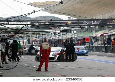 SEPANG - JUNE 19: Team mechanics working in the pitlane during the qualifying sessions of the Japan SUPER GT Round 3 at the Sepang International Circuit on June 19, 2011 in Sepang, Malaysia.