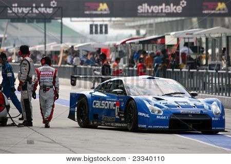 SEPANG - JUNE 19: Team Impul's Nissan GTR car leaves the pit-lane after tire change at the practice round of the Japan SUPER GT Round 3 race on June 19, 2011 in Sepang international Circuit, Malaysia.